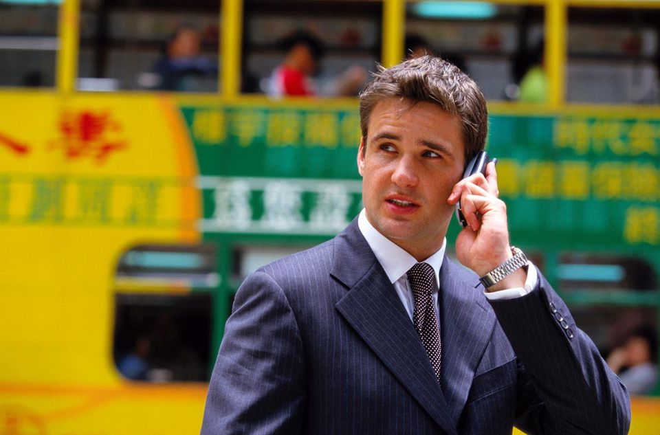 Businessman in the street on a mobile phone