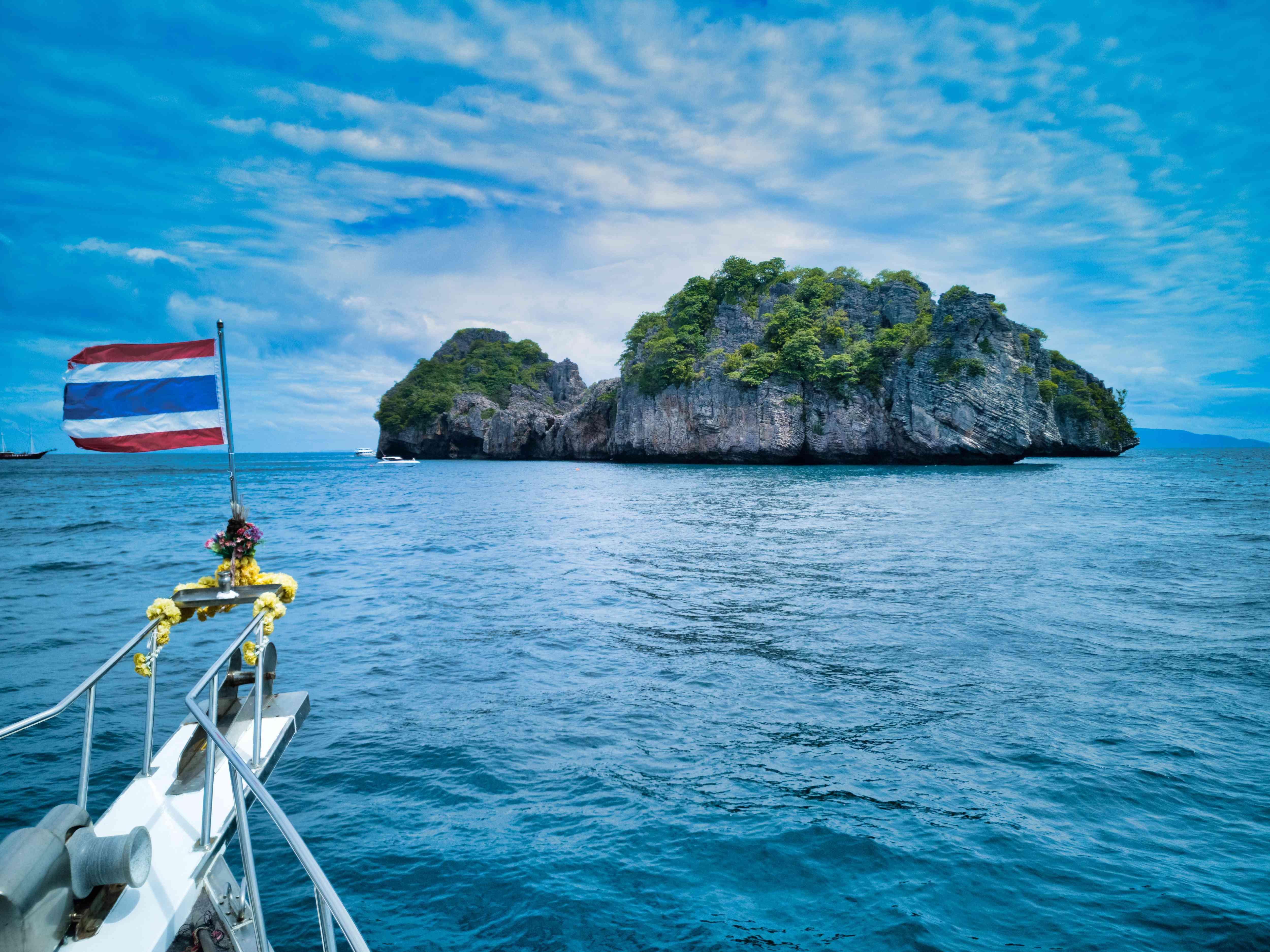 A dive boat approaches Koh Haa Island in Thailand