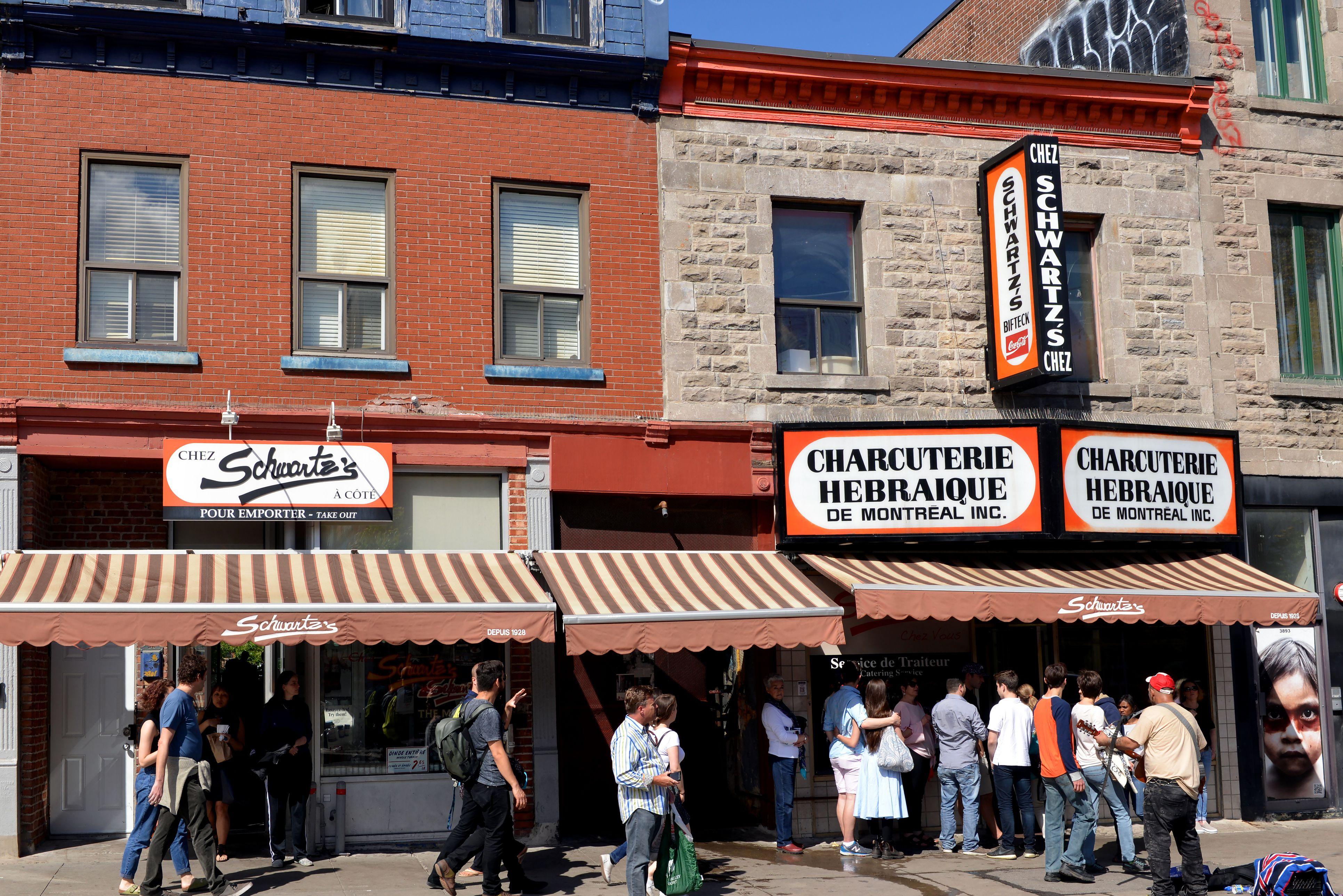 People standing outside of Schwartz's Deli in Montreal