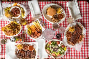 A table of barbecue dishes from overhead