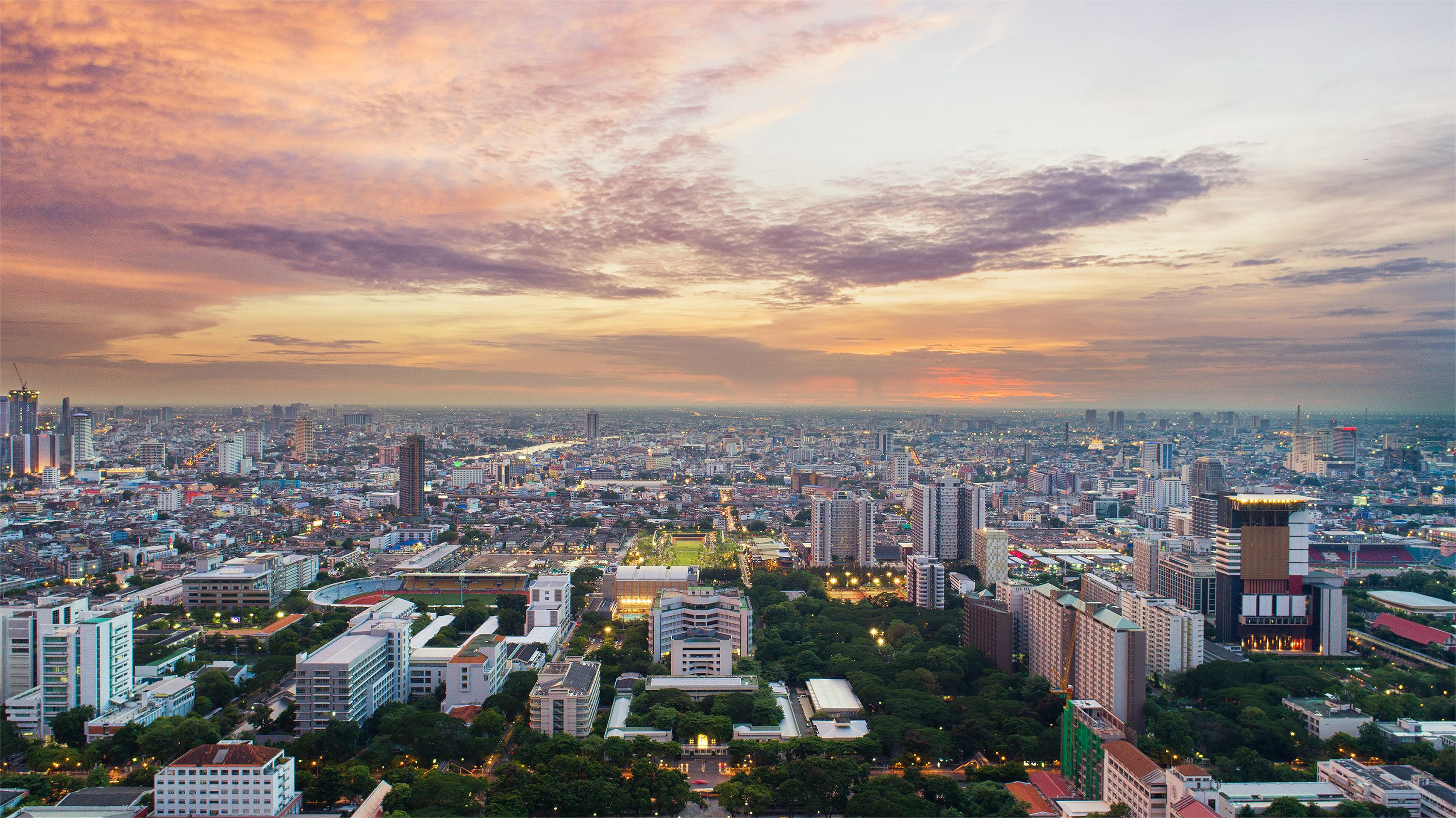 Bangkok city downtown with sunset sky ,Bangkok is the most populated city in Southeast Asia
