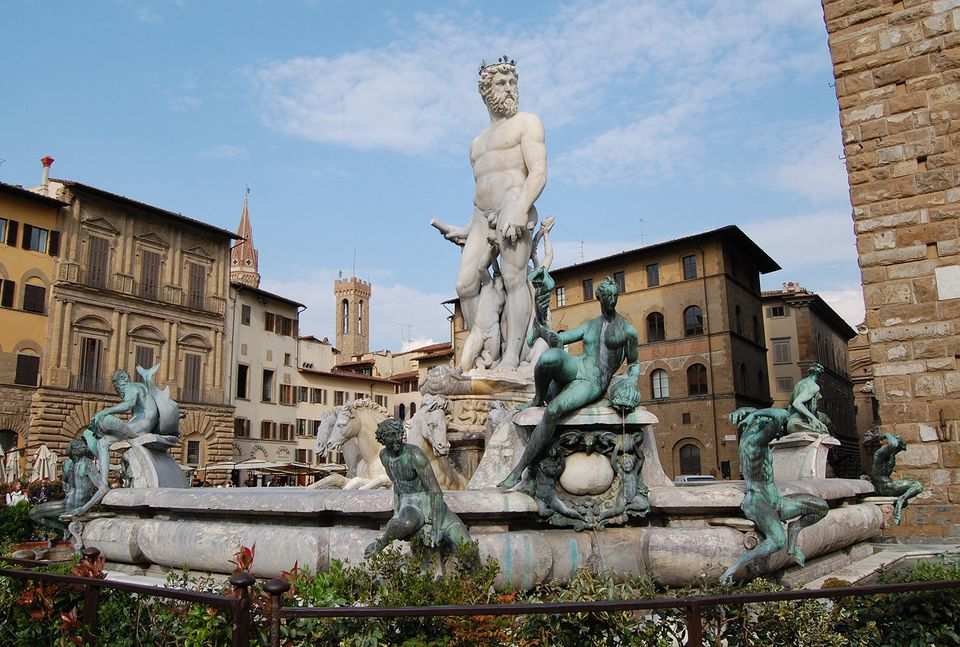 The Fountain of Neptune sits in the Piazza della Signoria to the left of the entrance.