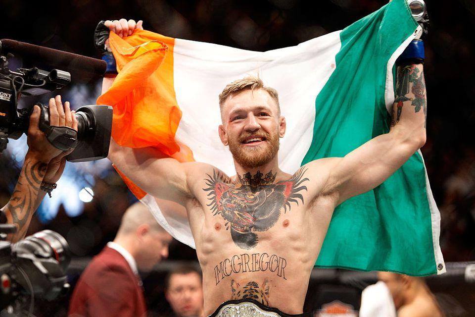 McGregor holding a flag