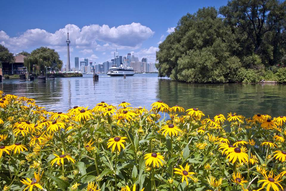 Toronto Center Island view towards downtown with ferry and CN Tower
