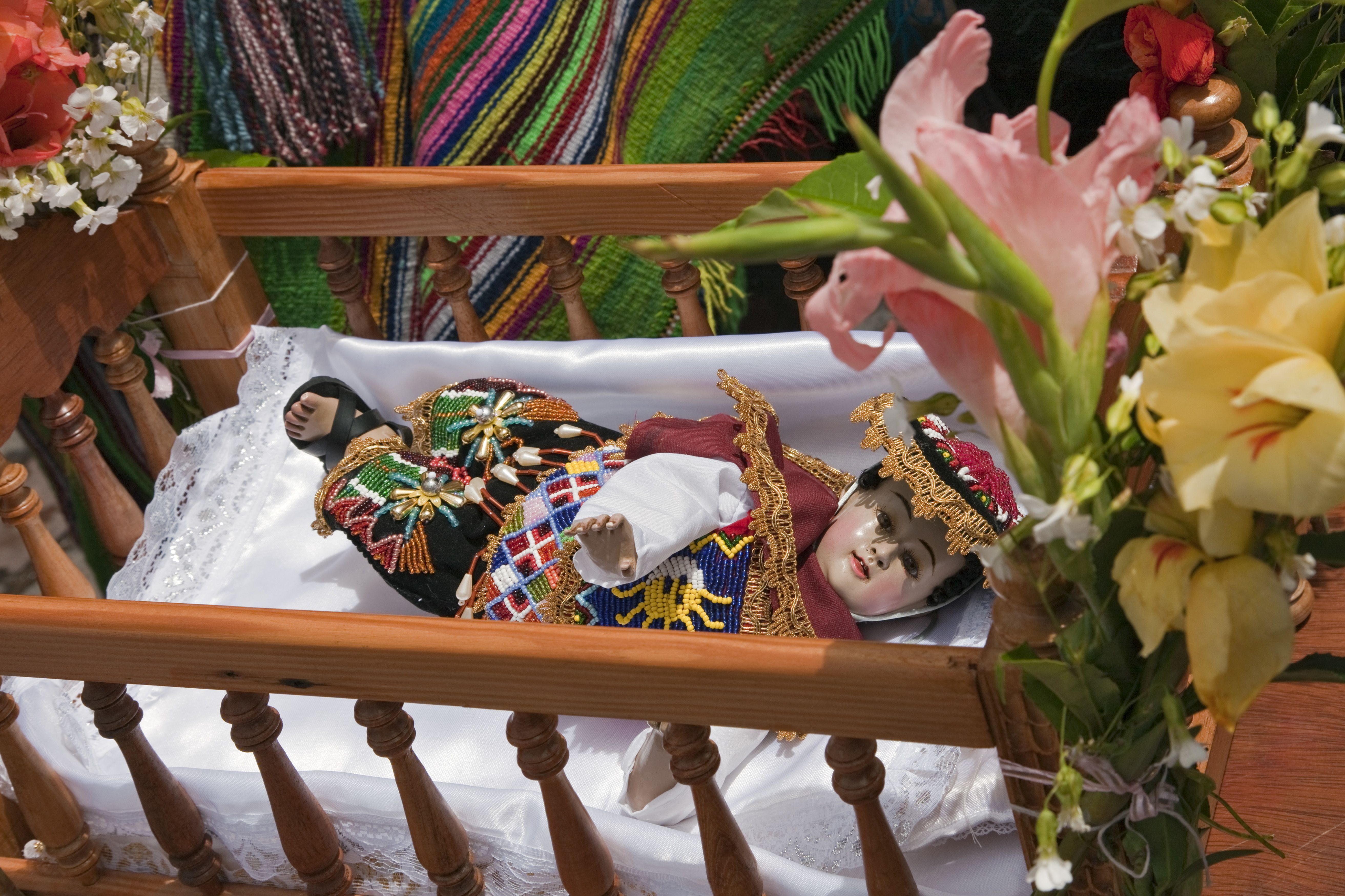 Peru, The Andean version of Baby Jesus, Nino Manuelito, is carried in cot by dancers during Christmas Day celebrations