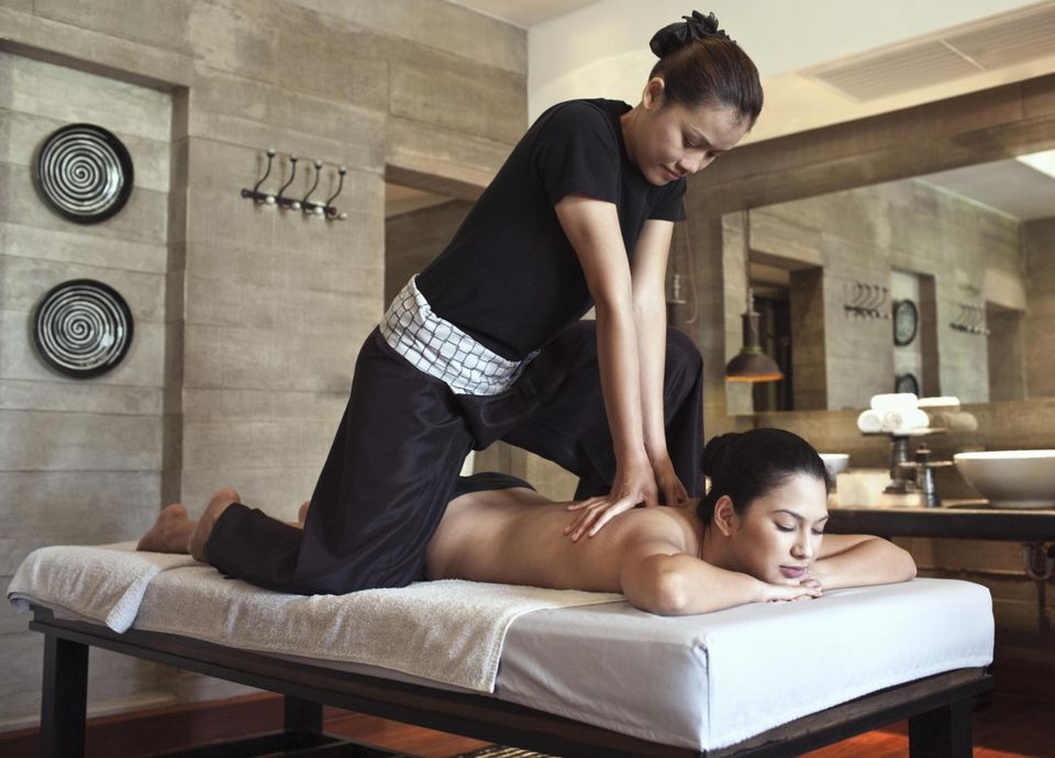 Woman Receiving Asian Massage