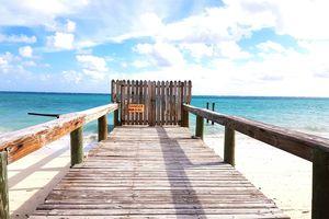 Wooden boardwalk with danger sign in Caribbean