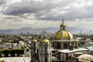 Guadalupe Basilica church and Mexico City skyline