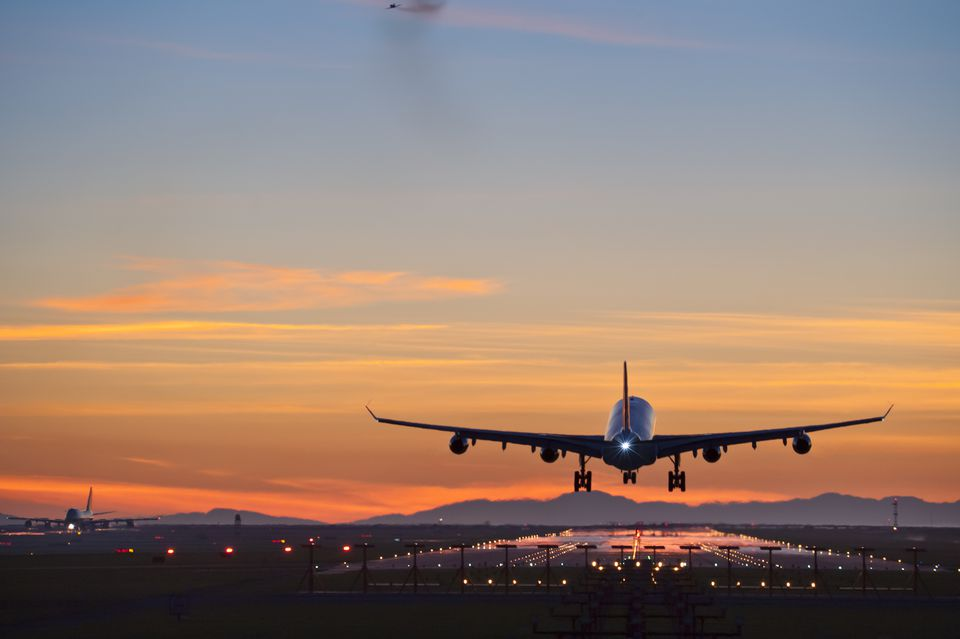 Airplane landing at Vancouver Airport at sunset