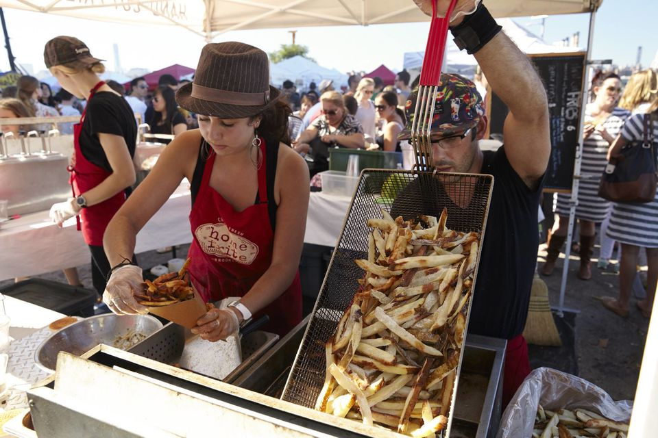 Cooks frying french fries at Prospect Park