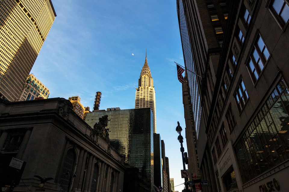 View of Empire State Building in between buildings in Manhattan