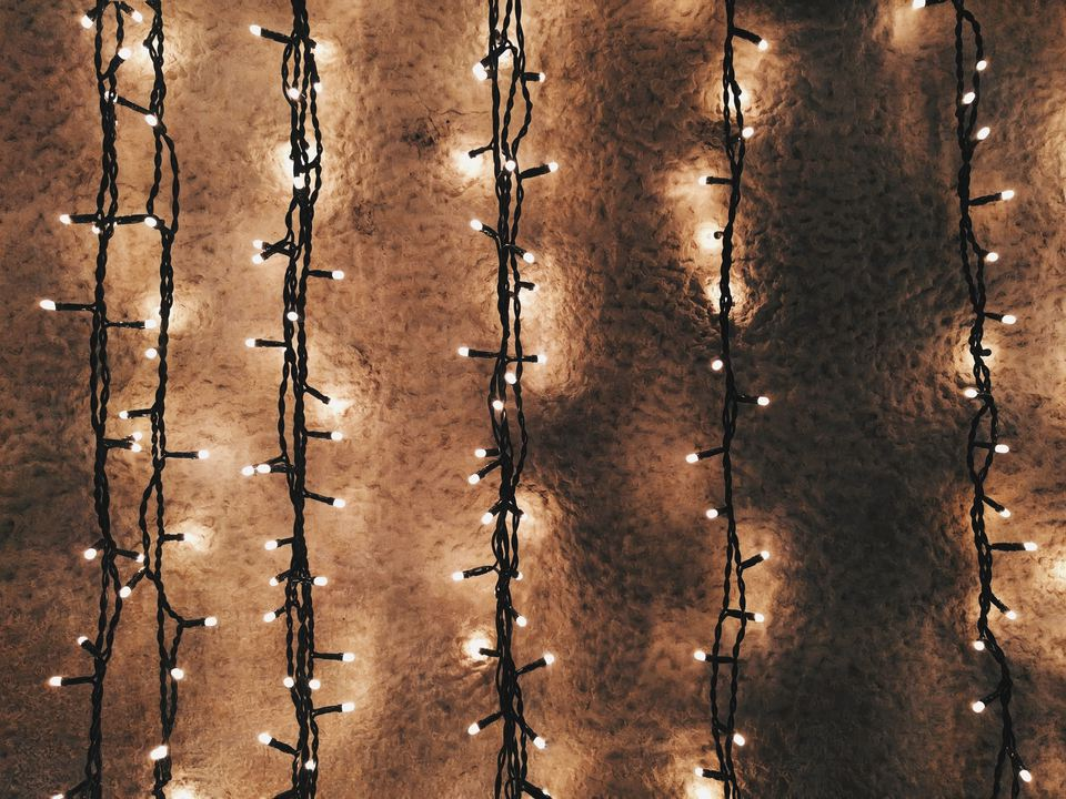 Full Frame Shot Of Wall With Illuminated String Lights At Night