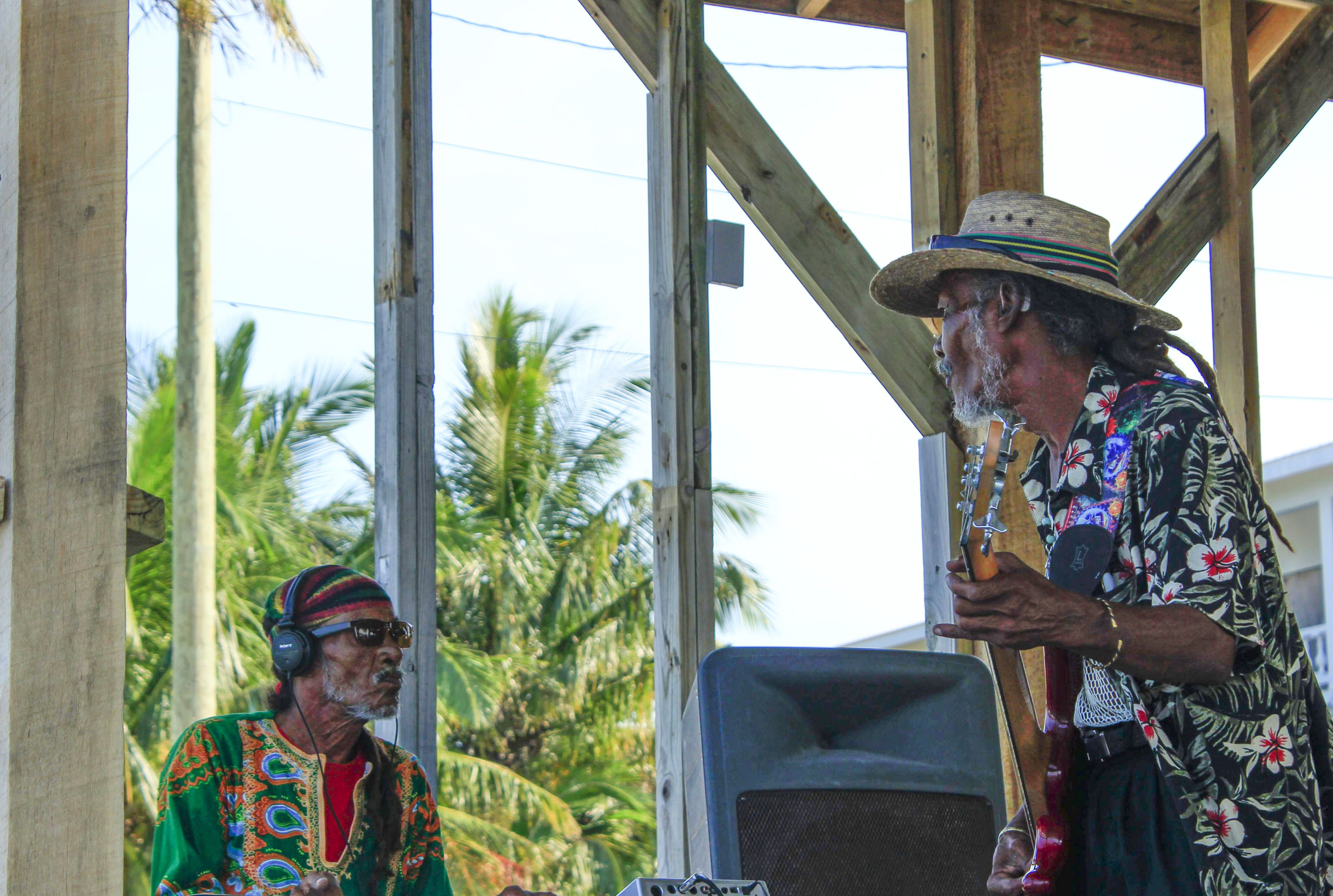 People playing island music on the Cayes