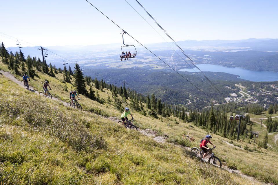 A family rides their bikes in Whitefish, Montana.