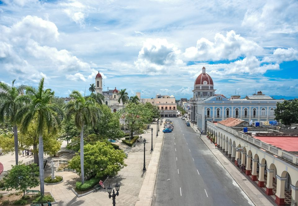 Plaza de Armas, Town Hall and Cathedral with dramatic sky, Cienfuegos, Cuba