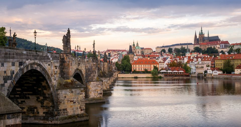 Photograph taken at sunrise Charles Bridge (left) St. Vitus Cathedral (Katedrála Sv. Víta) (right)