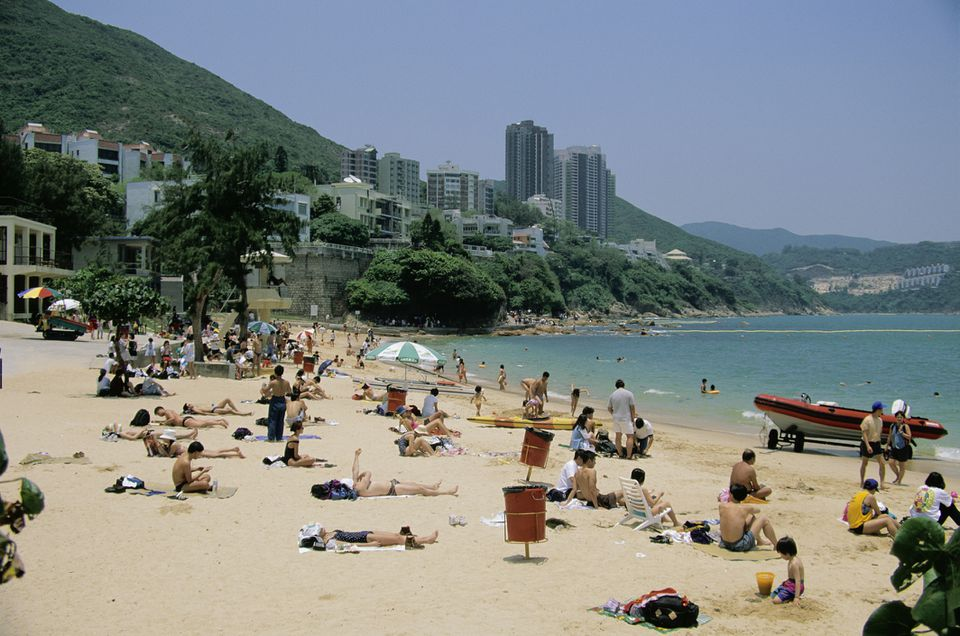 Sunbathers on Stanley Main Beach, Hong Kong