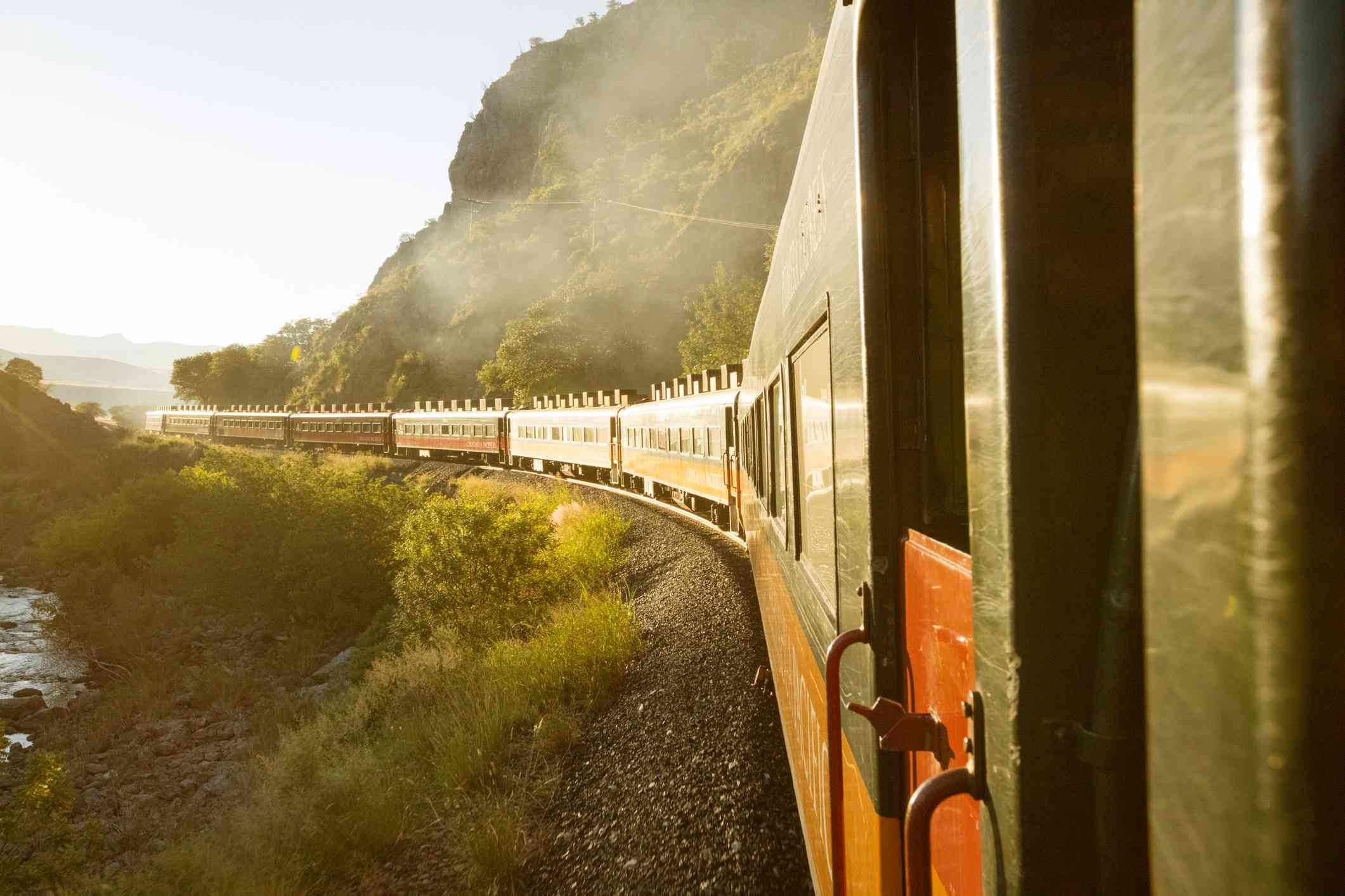 View of train going around a bend from a rear car, Copper Canyon Railway