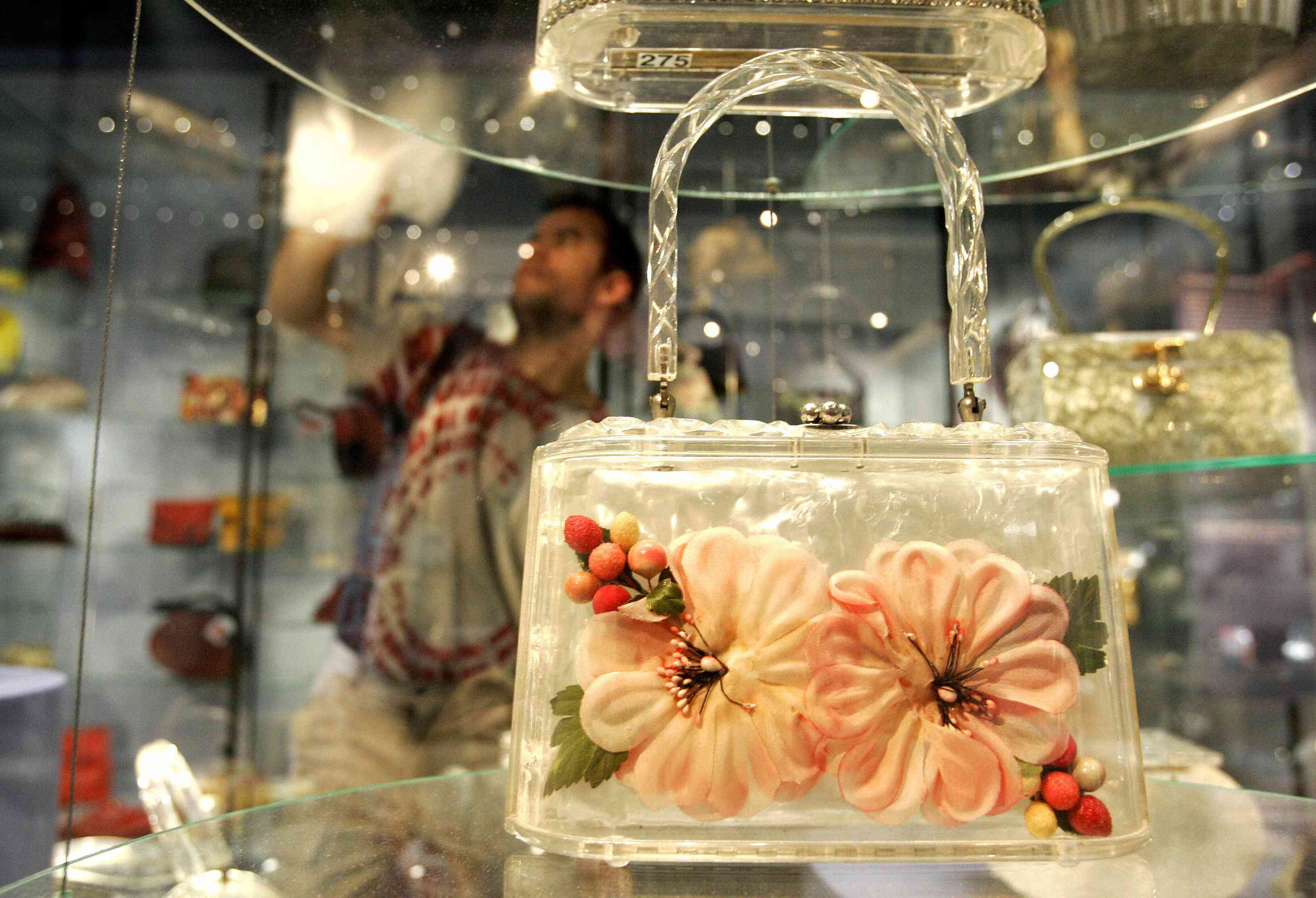 Bags and purses are displayed at a museu...