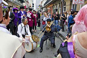 Crowd celebrating Mardi Gras on Bourbon Street, New Orleans, Louisiana