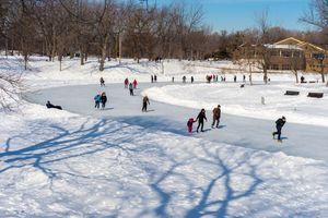 People skating at Lafontaine Park natural ice rink