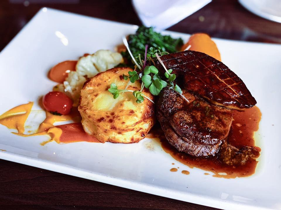 Plate with steak, potatoes, and cauliflower.