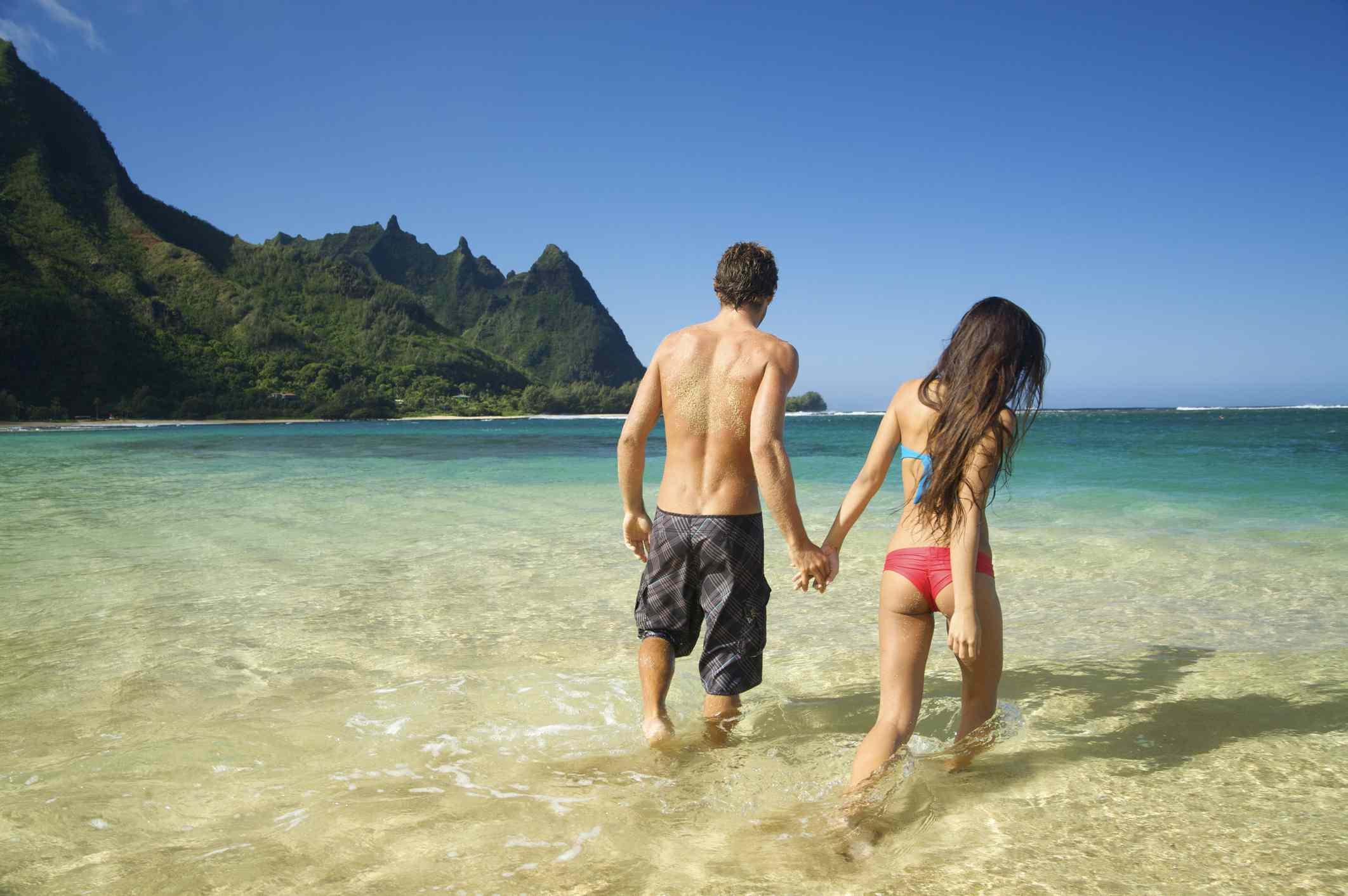 Couple in the Water at Tunnels Beach, Kauai