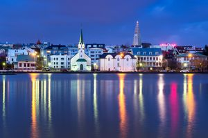 reflections of the city of Reykjavik, Iceland in the water