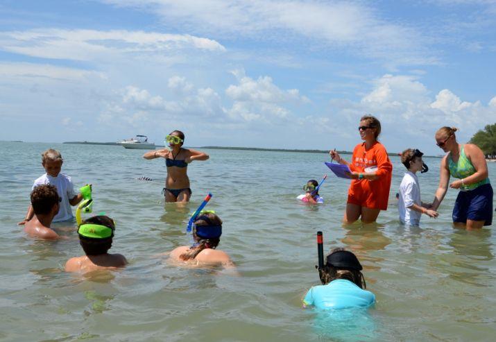 Kids snorkeling as part of the Sanibel Sea School