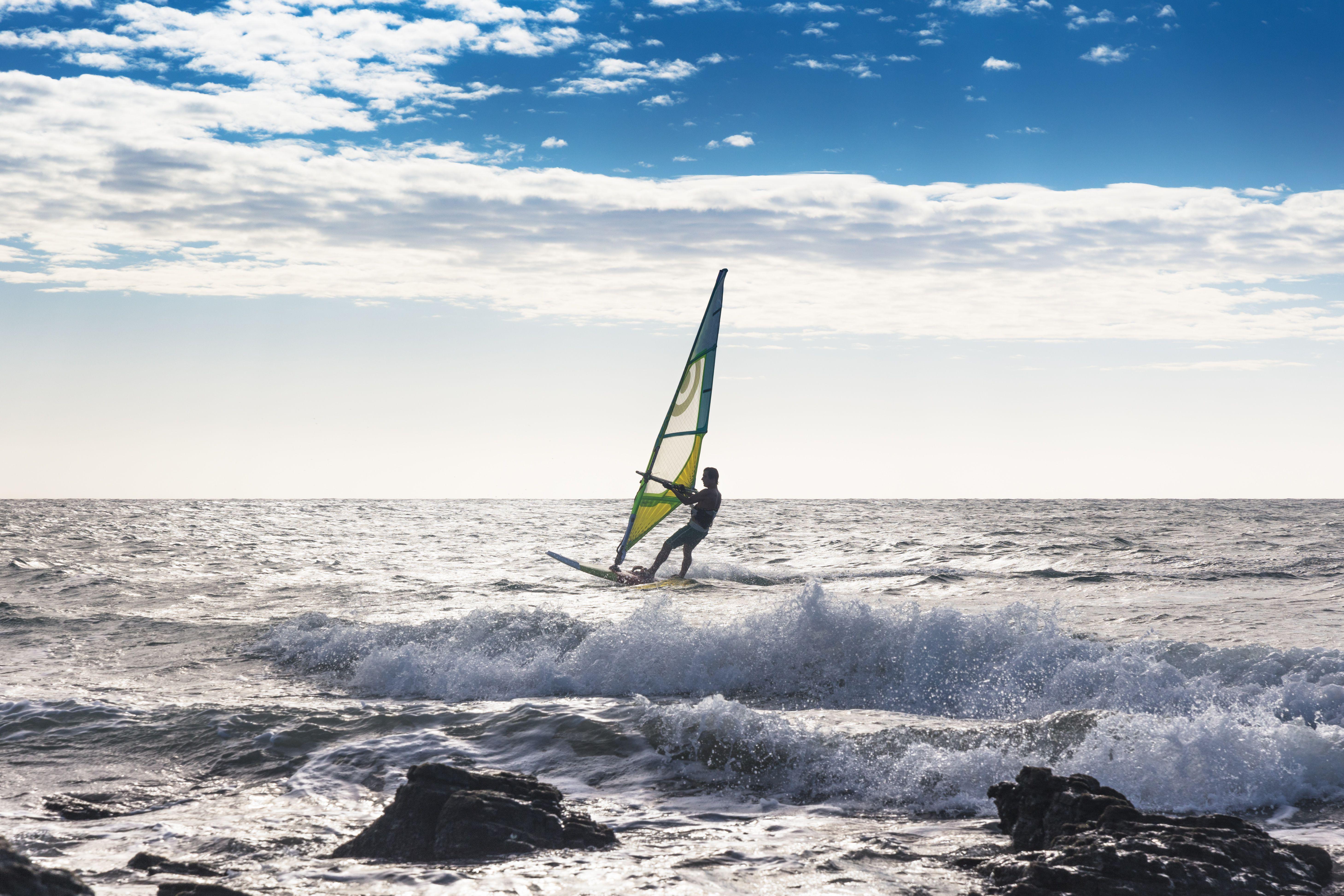 Man windsurfing in sea, Jericoacoara National Park, Ceara, Brazil