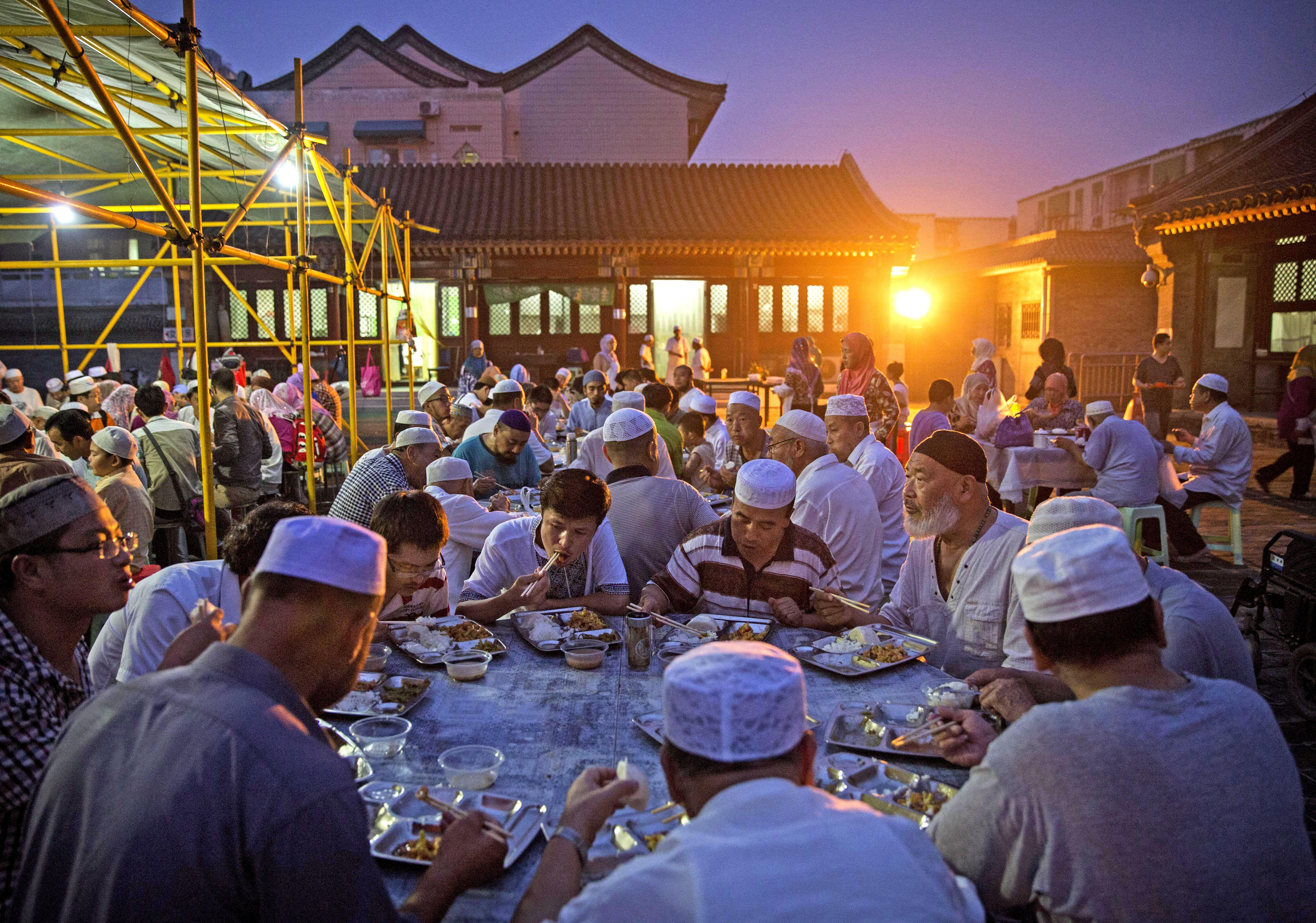 Muslims eating during Ramadan in Asia