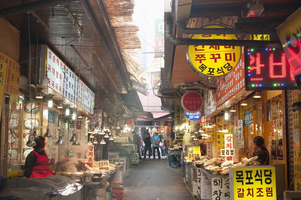 Female vendors and food stalls on display in food lane near Gate 2 at Namdaemun Market, Namdaemunno Road, Namdaemun.