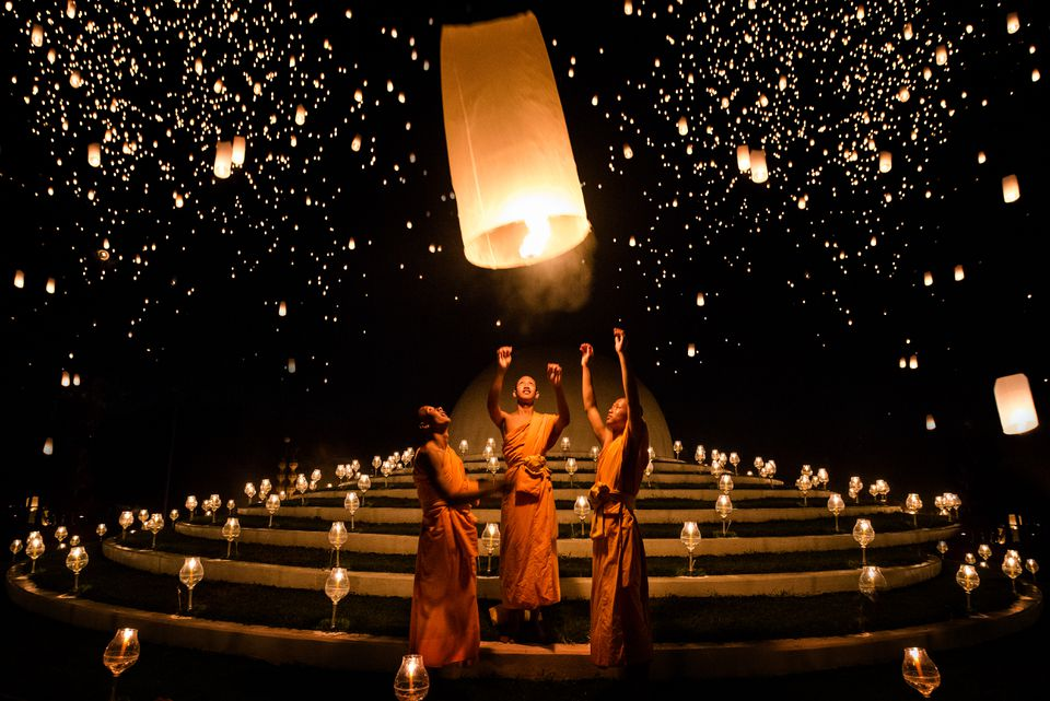 Monks release lanterns during Yi Peng, a fall festival in Asia