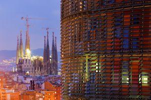 Iconic architecture in Barcelona: Agbar Tower, Jean Nouvel (right) and Sagrada Familia, Gaudi (left)