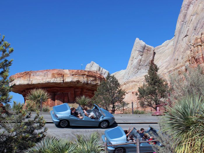 Two carloads of guests peel out and race one other in Radiator Springs Racers.