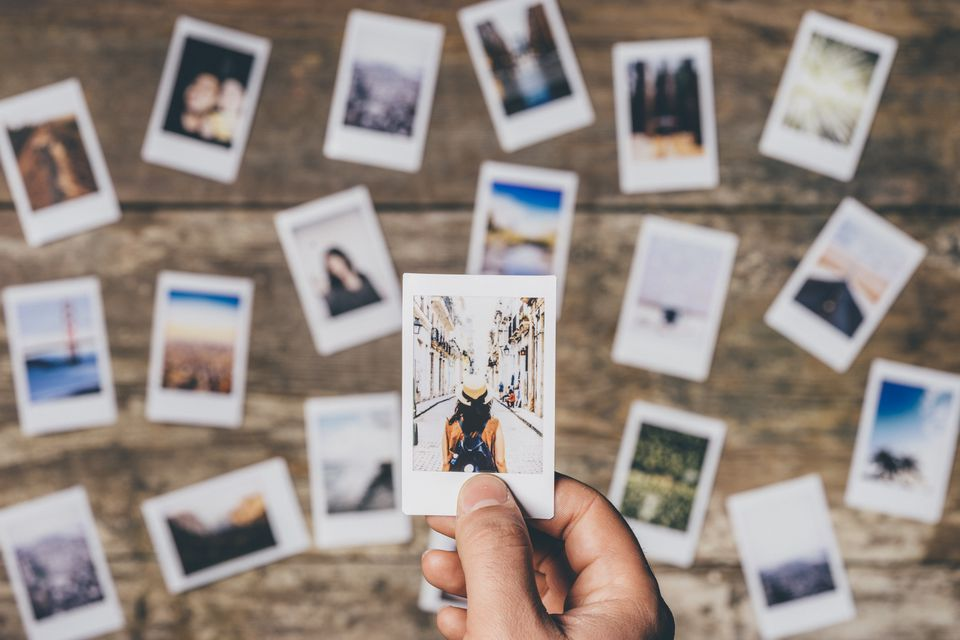 Instant camera prints on a table