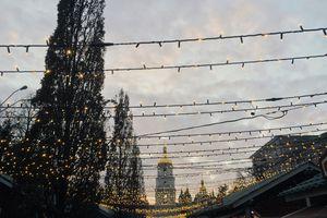 Illuminated Lights Over Street Against Church