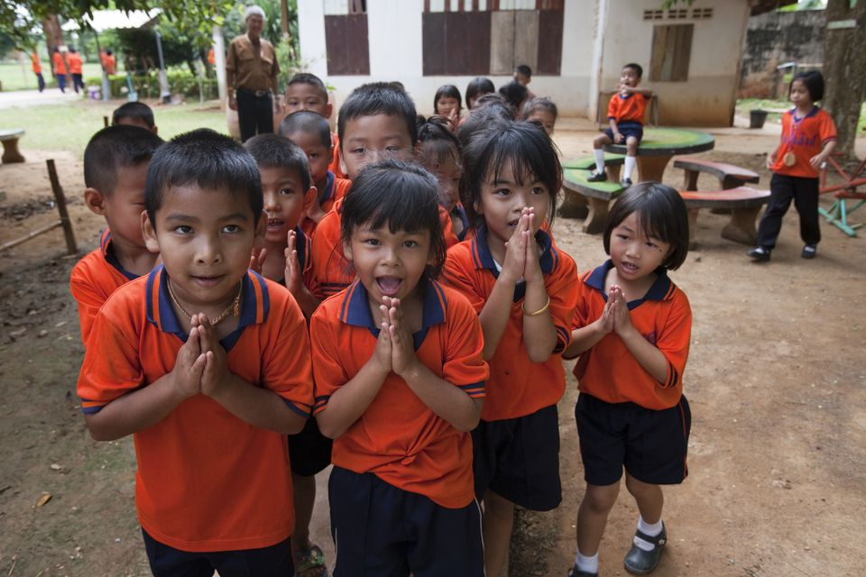 "Thai children performing the local greeting known as the ""wai"""