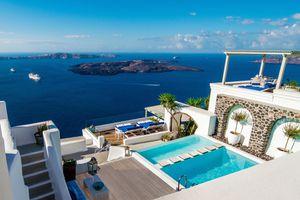 The swimming pool overlooks the Caldera at Iconic Santorini