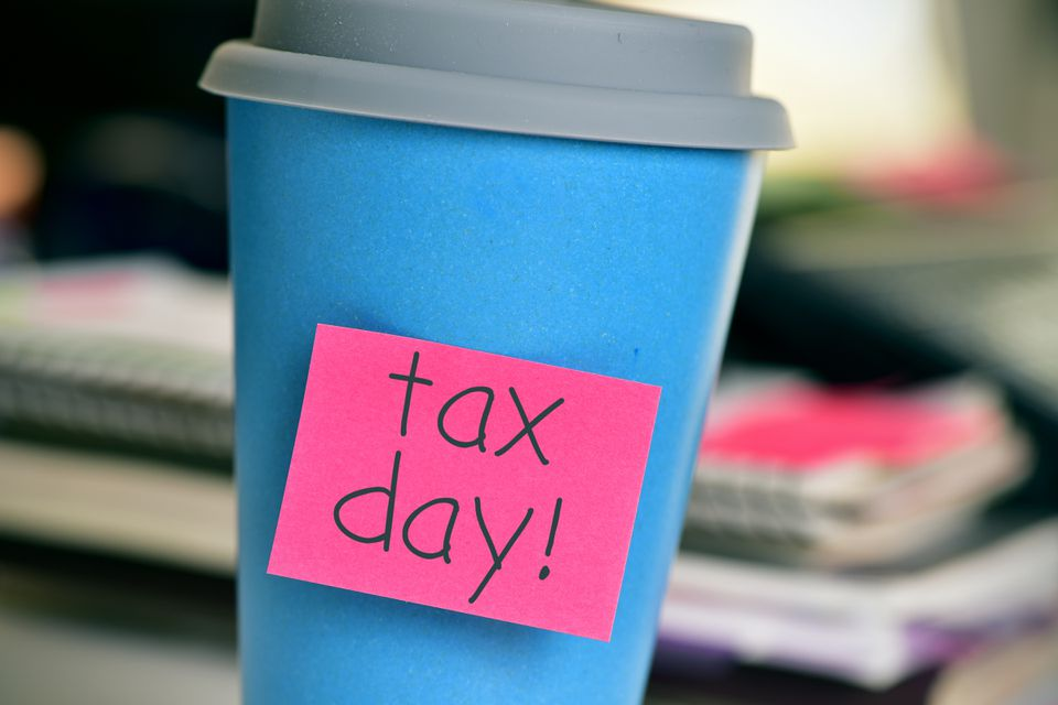 coffee cup with the text tax day in the office