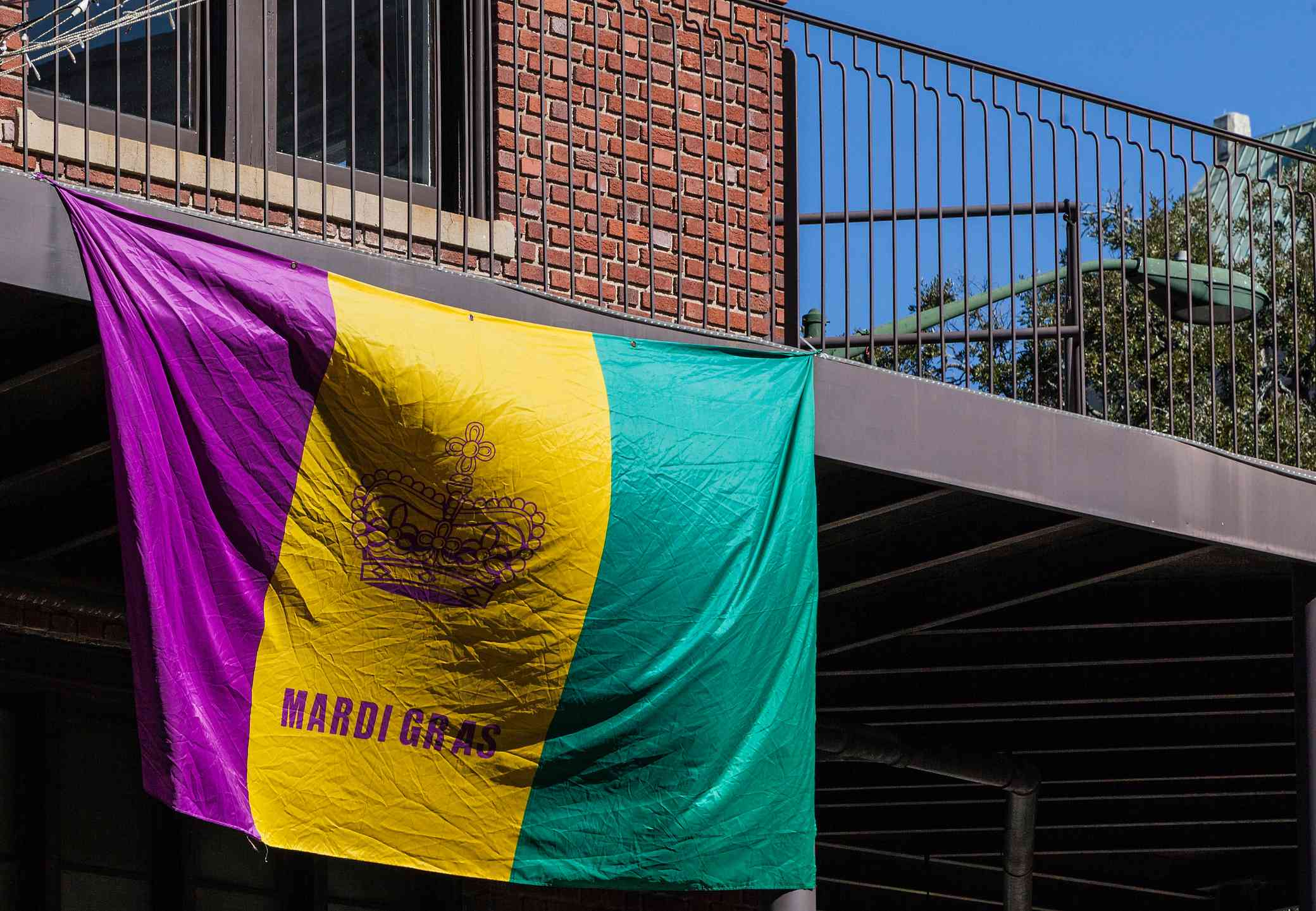 A balcony decorated with the Mardi Gras flag at the parade in Mobile, Alabama