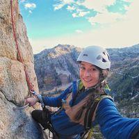 Suzie Dundas taking a selfie while rock climbing