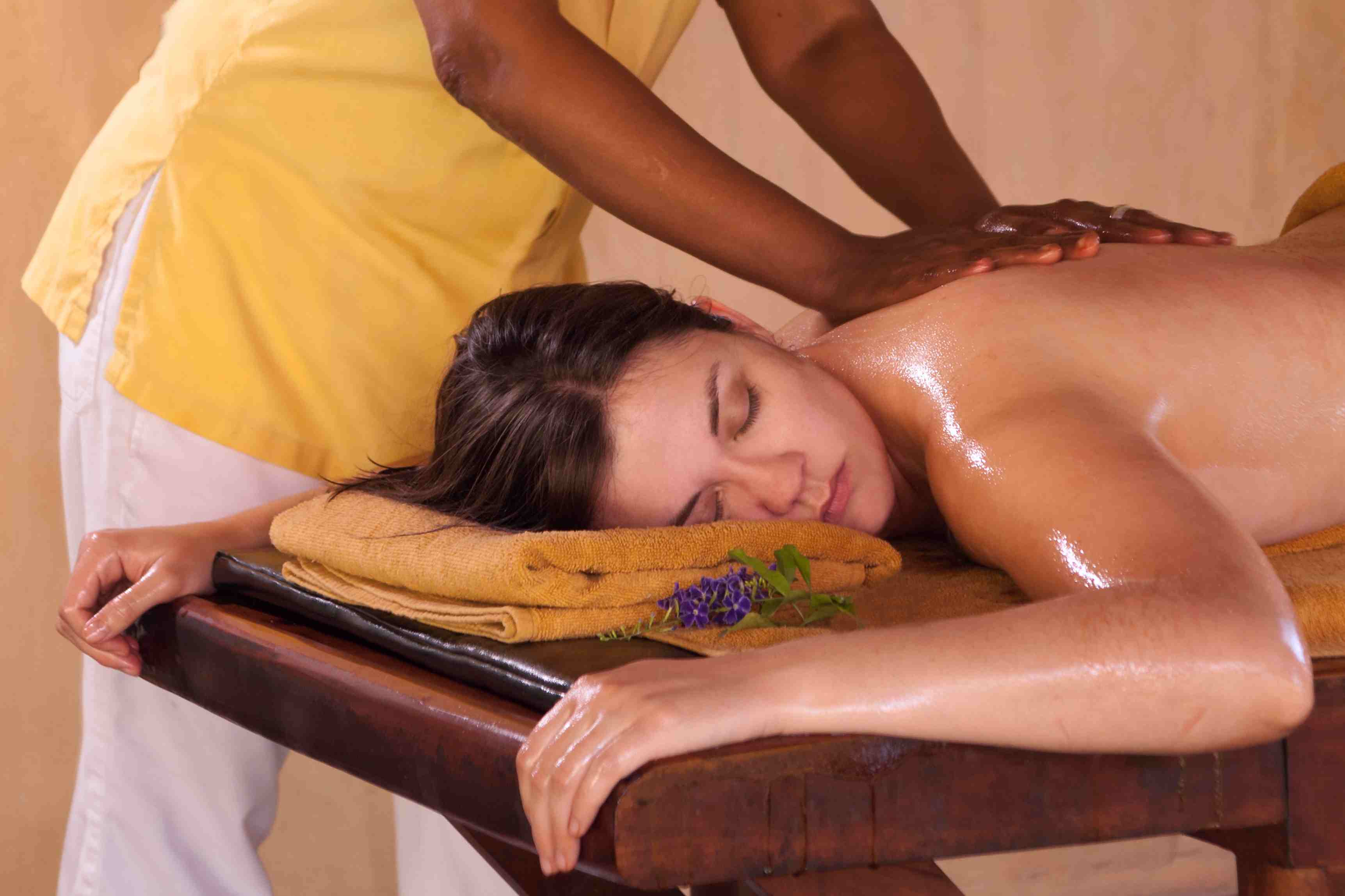 Woman receiving an Ayurveda herbal oil body massage, an ancient form of healing and well-being, Sri Lanka