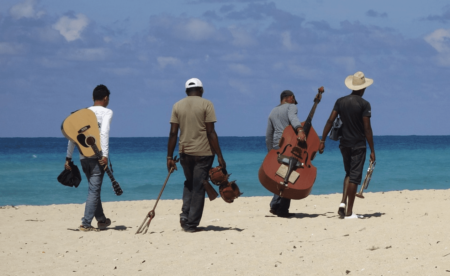 Jazz musicians on the beach with instruments