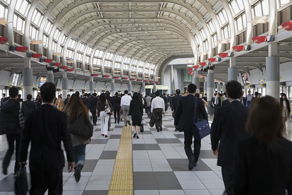 Japanese business etiquette people in railway station m4hsunfo