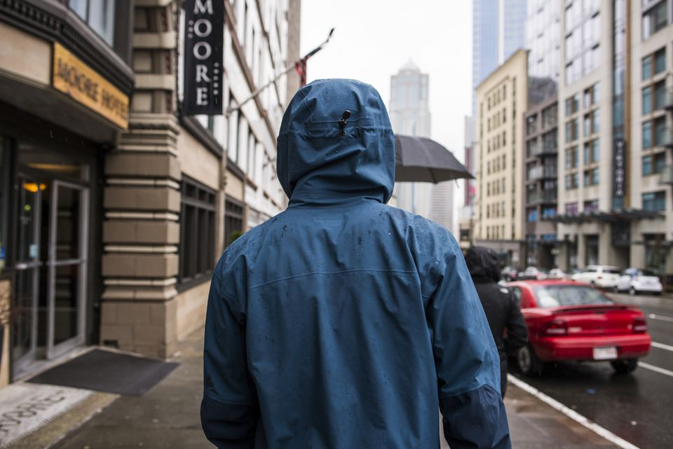 person wearing raincoat on Seattle street