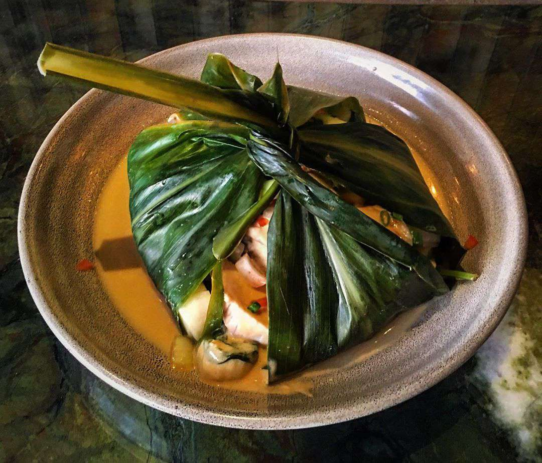 Seafood lau lau, or cooked seafood wrapped in banana leaf, in a bowl from Ko in Maui