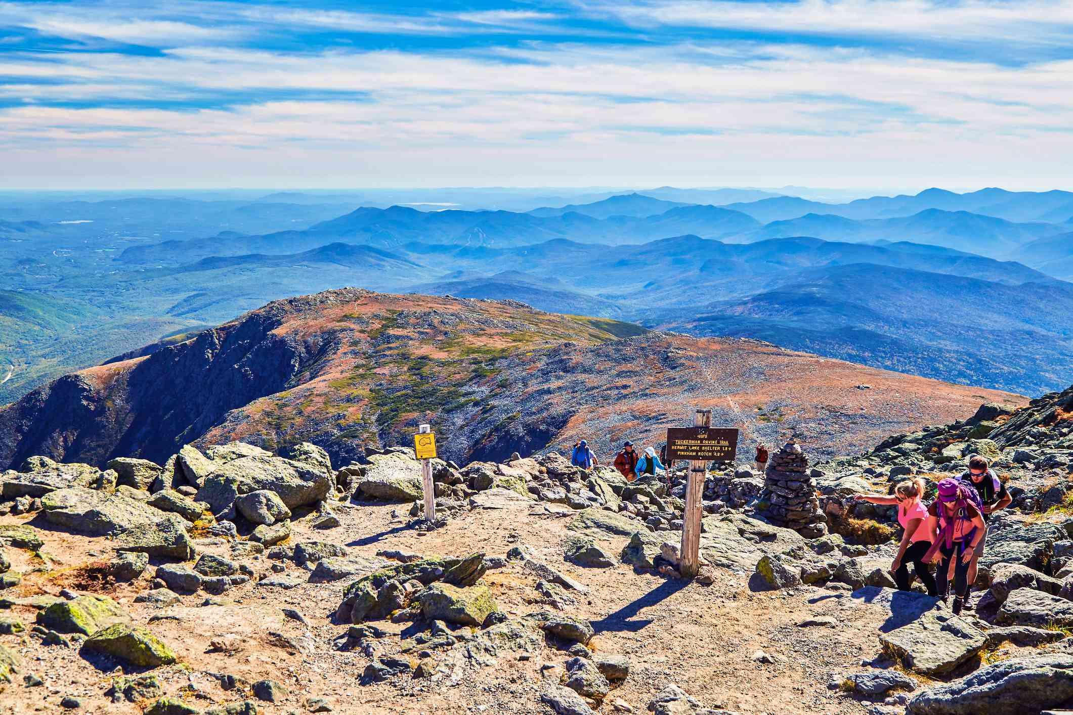 people on a rocky mountain summit
