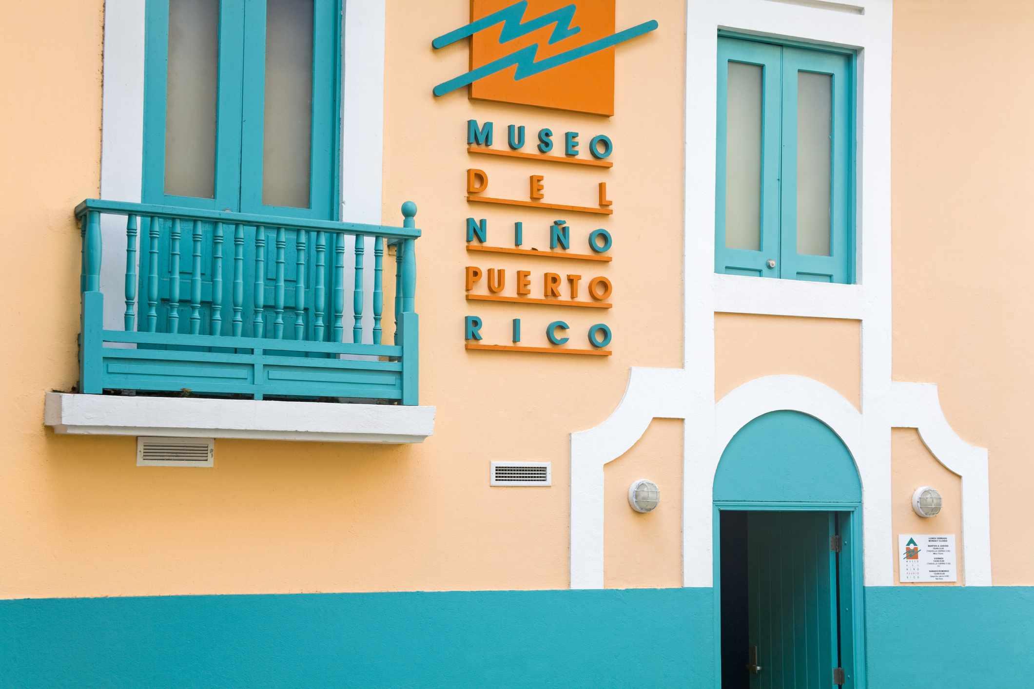 Blue and pastel orange exterior of the Children's Museum in Old San Juan