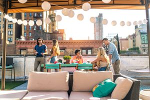 Group of friends on NYC rooftop bar